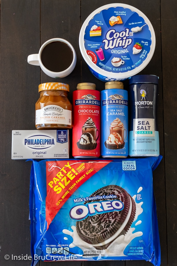 Overhead picture of the ingredients needed to make a Salted Caramel Oreo Icebox Cake on a dark board