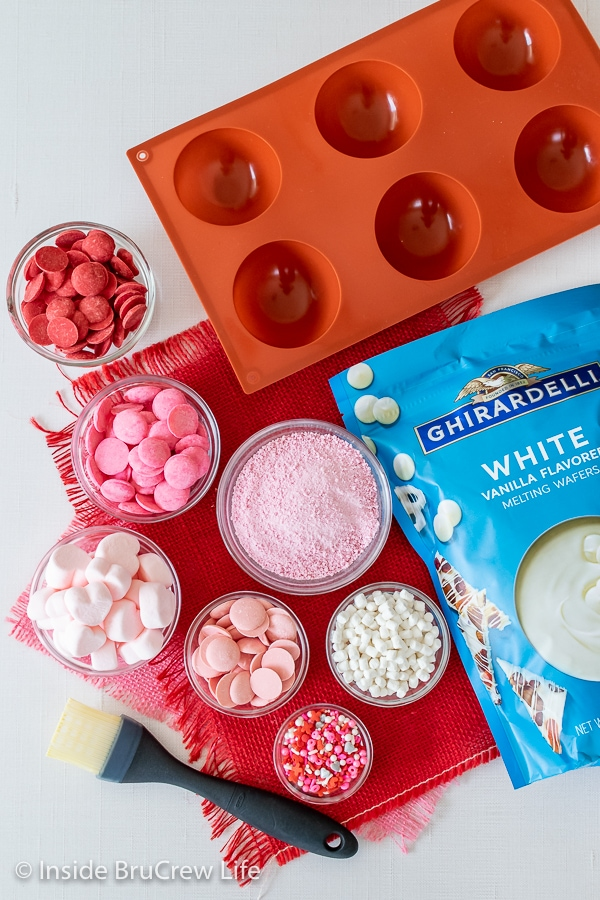 Overhead picture of the ingredients needed to make strawberry white hot chocolate bombs