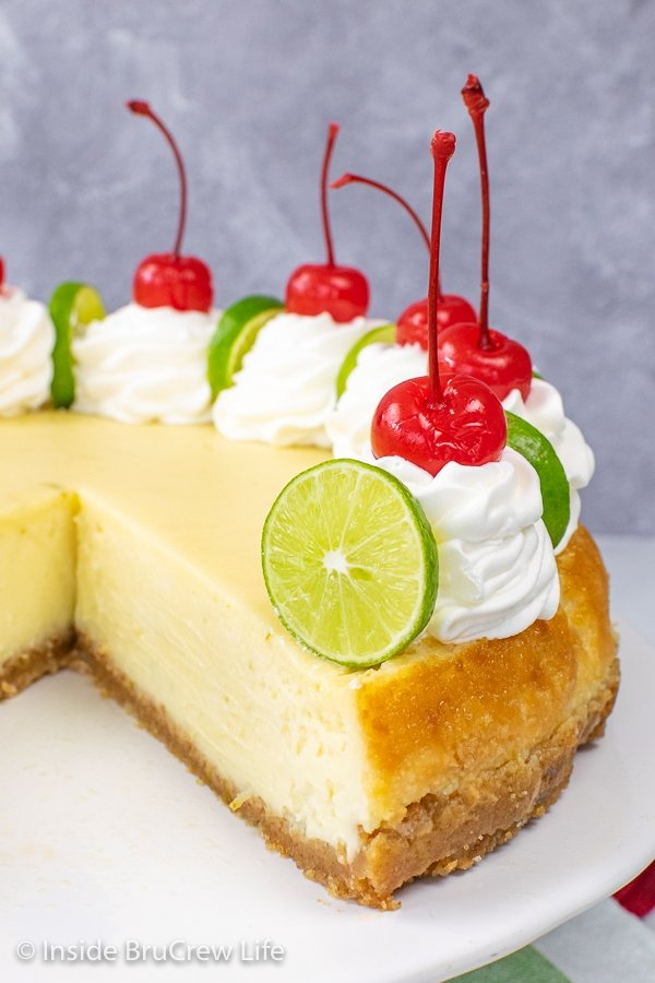 Close up picture of the inside of a key lime cheesecake showing how creamy it is.