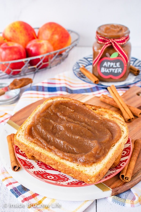 A plate with a slice of toast with apple butter spread on it.