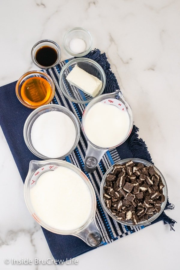 A white board with bowls of ingredients needed to make Oreo Ice Cream.