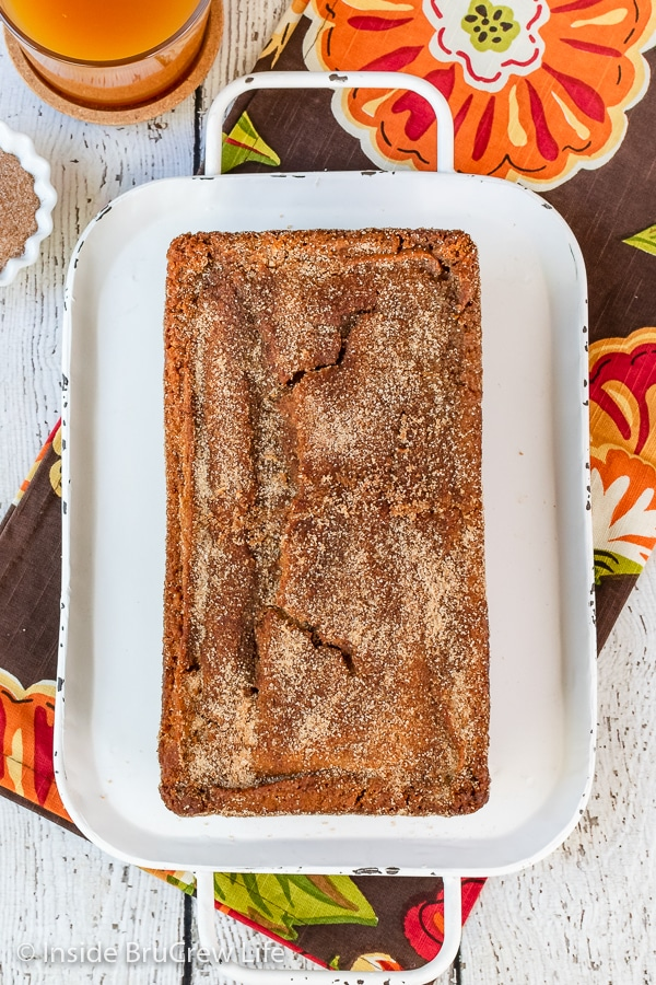 Overhead picture of a loaf of apple bread covered with cinnamon sugar.
