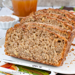 Slices of apple cider bread on a white tray.